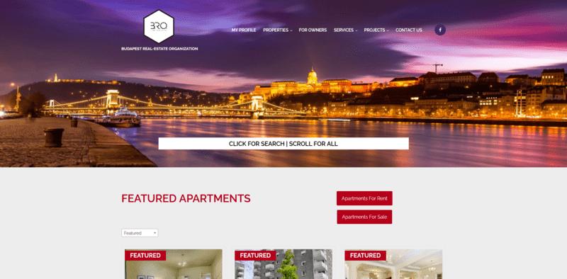 Honlap nyitóoldala budapesti látképpel és apartmanokkal.